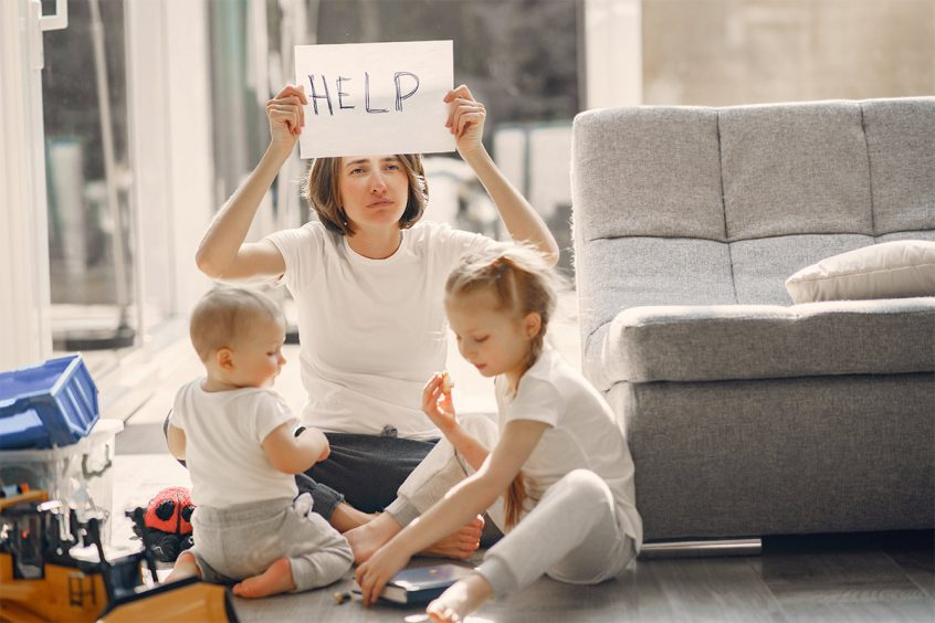"Photo of mom with ""Help"" sign"